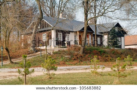 Traditional polish wooden noble house. - stock photo