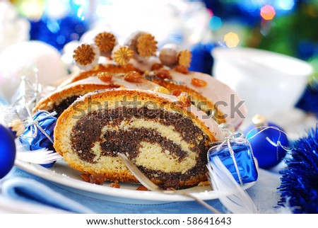 traditional   poppy cake with icing and raisins for christmas - stock photo
