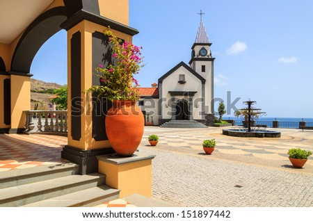 Traditional Portuguese church building and square with ocean view, Madeira island, Portugal - stock photo