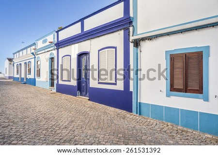 Traditional Portuguese street. Ancient architecture. - stock photo