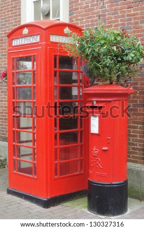 Traditional post box and phone box in England, in red colour - stock photo