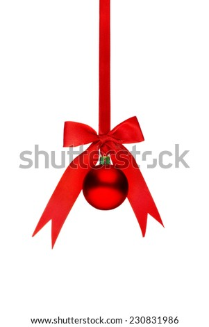 Traditional red Christmas ball hanging on a red ribbon isolated on white background
