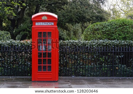 Traditional red telephone box, K2 model in London, England, UK - stock photo