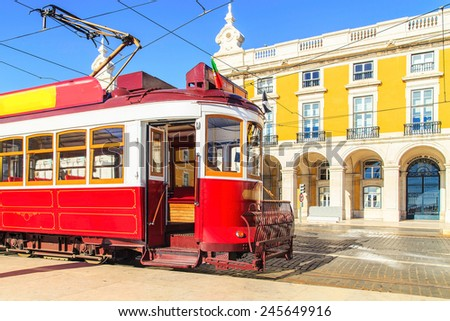 Traditional red tram on a street near Praca de Comercio in Lisbon, Portugal - stock photo
