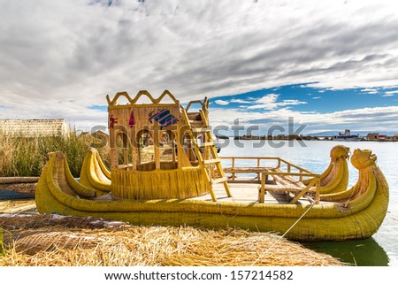 Traditional reed boat lake Titicaca,Peru,Puno,Uros,South America,Floating  Islands,natural layer about one to two meters thick that support islands - stock photo