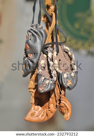 Traditional Romanian peasant sandals at souvenir market. - stock photo