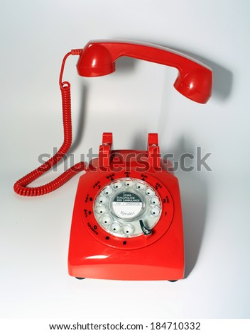 traditional rotary dial phone make a on call, handset pick up by hollow man  - stock photo