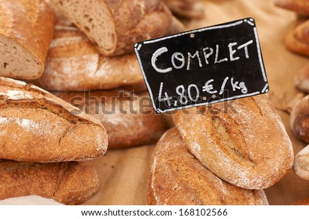 Traditional rural bread on market stall in Aix en Provence, France - stock photo