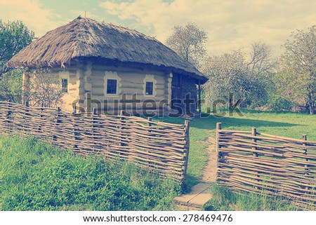 Traditional rural house in Ukraine.Vintage filter - stock photo