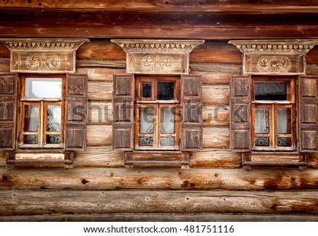 Traditional Russian architecture, wooden windows with frames. Travel in Russia.
