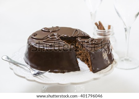 traditional sacher cake sliced on white plate - stock photo