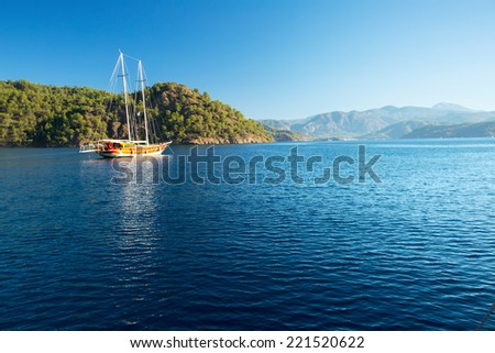 Traditional sail boat anchored in the calm bay of Skopea Limani, Turkey - stock photo