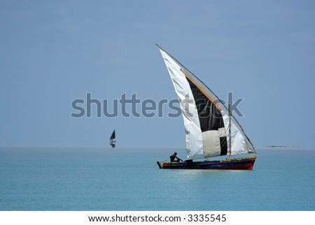 Traditional sail boat called a dhow, Vilanculos coastal sanctuary, Mozambique - stock photo
