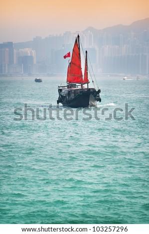 Traditional sailing junk boat in Hong Kong - stock photo