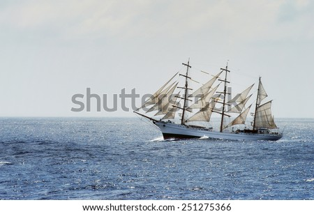 Traditional sailing ship cross from Mediterranean sea to Atlantic ocean during rough sea and  strong wind.