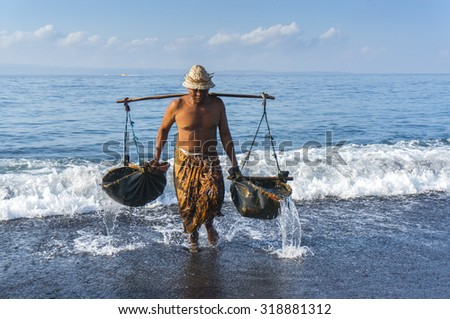 Traditional salt farmer at kusambar bali island, indonesia