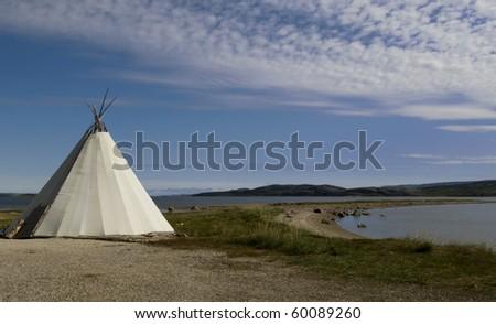 Traditional Sanmi reindeer-skin tent (lappish yurt) in Finnmark region of Norway - stock photo