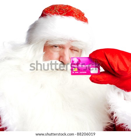 """Traditional Santa Claus holding and sowing credit card while giving a big """"ho ho ho"""" belly laugh. Isolated on white. - stock photo"""