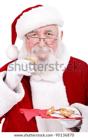 traditional Santa eating gingerbread,  isolated on white background - stock photo