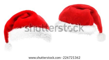 Traditional Santa hats on white - stock photo
