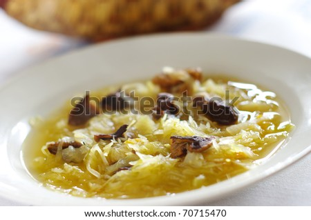 Traditional sauerkraut soup with mushrooms - stock photo