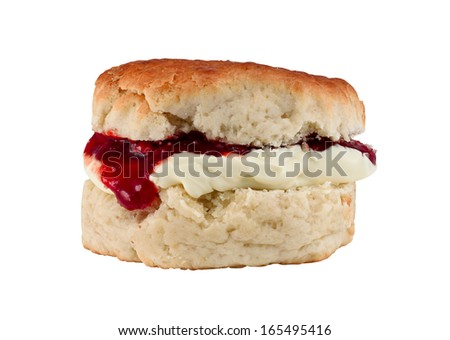 Traditional Scone with clotted cream and strawberry jam often served as afternoon tea isolated on white - stock photo