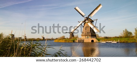 Traditional setting of the historical dutch windmills landscape at Kinderdijk near Rotterdam, the Netherlands, an UNESCO world heritage site