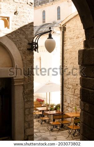 Traditional sidewalk restaurant in Sibenik, Croatia - stock photo