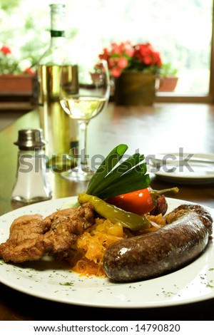 Traditional Slovak sausage with vegetables, white wine in Traditional Slovak Restaurant