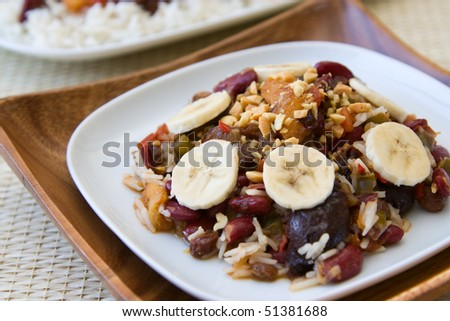 Traditional South African vegetarian curry made from kidney beans and dried fruits, served with rice. - stock photo