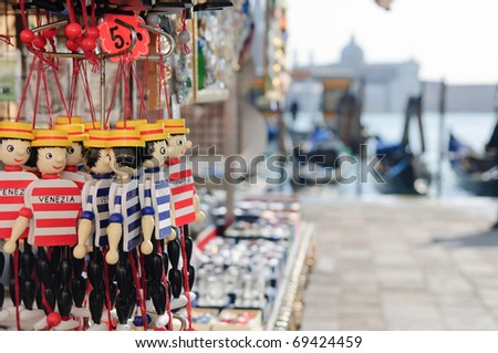 "Traditional souvenirs ""gondoliers"" in Venice - stock photo"