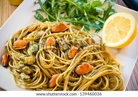 Traditional spaghetti with mussels meat and pesto - stock photo