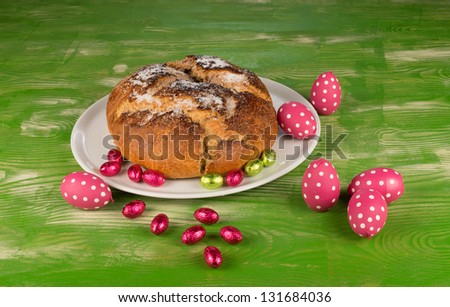 Traditional Spanish mona de pascua with  Easter egg decoration