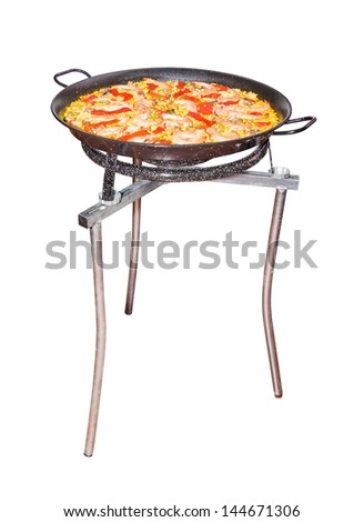 Traditional spanish paella in a pan, isolated on white background