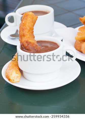 traditional spanish pastry - churros with chocolate - stock photo