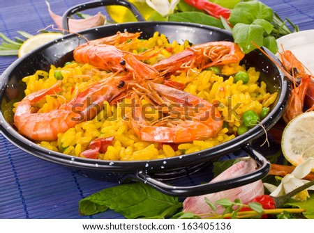 traditional spanish rice - paella closeup typical Spanish food, Mediterranean food - stock photo