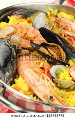 Traditional Spanish seafood paella with clams, mussels and king prawns