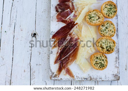 Traditional spanish tapas. Appetizer with spanish Ham and Cheese.Natural food concept. - stock photo