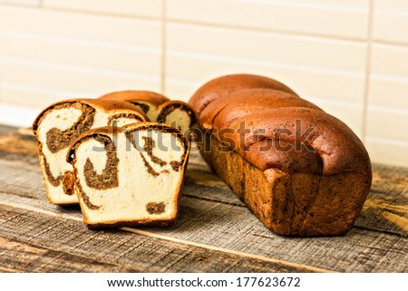 Traditional sponge cake for Easter or Christmas on wooden table - stock photo