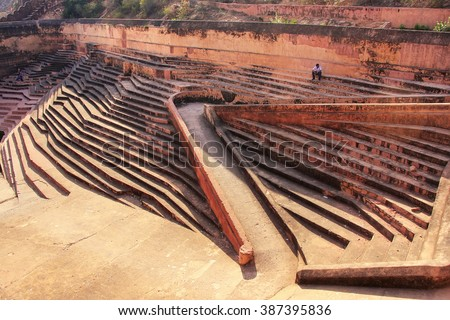 Traditional stepwell at Nahargarh Fort in Jaipur, Rajasthan, India. The fort was constructed as a place of retreat on the summit of the ridge above the city. - stock photo
