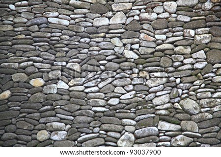 Traditional Stone Brick Wall Fragment Stones in Irregular Shapes - stock photo