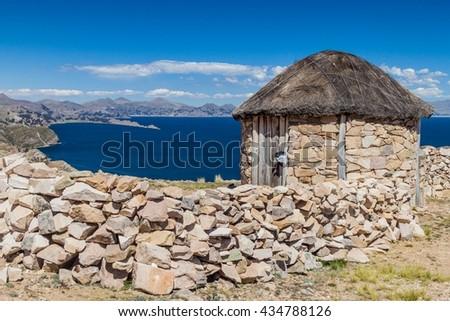 Traditional stone hut on Isla del Sol (Island of the Sun) in Titicaca lake, Bolivia - stock photo