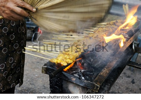 Traditional style beef satay on bamboo stick grilled on coal flame. - stock photo