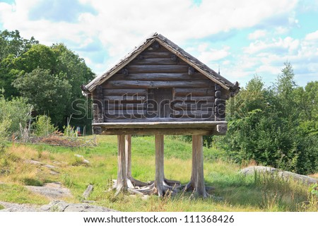 Traditional Swedish wooden hut, Skansen, Stockholm - stock photo