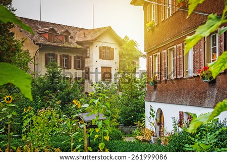 Traditional swiss village in Alps against lake Lucerne, Switzerland - stock photo