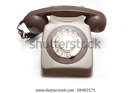 Traditional telephone isolated on a white studio background.