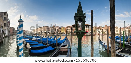 Traditional 16th century villas, blue skies and gondolas along the Grand Canal in Venice. - stock photo