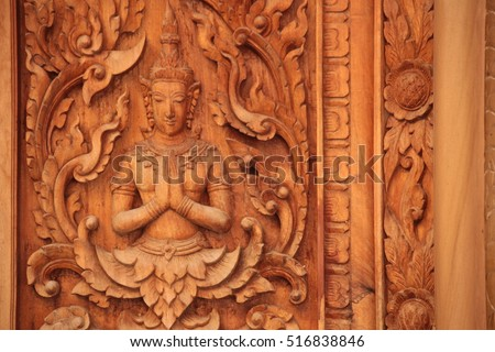 Traditional Thai Art in wood carving for decoration on Buddhist temple doors or windows.