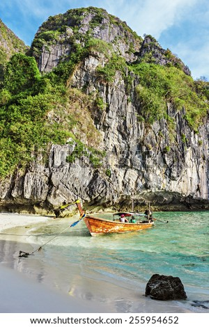 Traditional Thai boat and island of Phi Phi Leh ,Thailand - stock photo