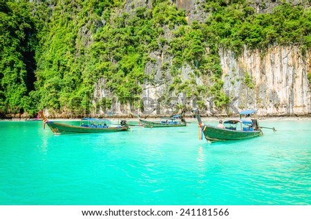 Traditional Thai boats or long tail boats against the azure water, Phi Phi Islands, Thailand - stock photo